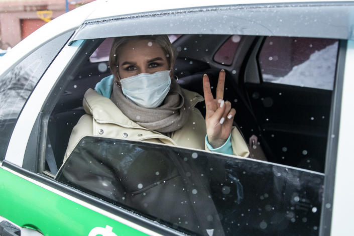 Lyubov Sobol, a Russian opposition activist, is driven in a prison car to the headquarters of the Investigative Committee in Moscow, Russia, Thursday, Feb. 4, 2021. Following Navalny's arrest, authorities also have moved swiftly to silence and isolate his allies. On Thursday, Feb. 4, 2021, Sobol was formally charged with the incitement of violation of sanitary regulations by organizing protests. (AP Photo/Pavel Golovkin)