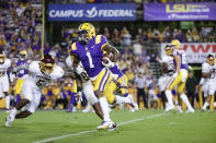 LSU wide receiver Kayshon Boutte (1) runs past Central Michigan linebacker Troy Brown (8) and defensive back Devonni Reed (5) for a touchdown during the second quarter of an NCAA college football game in Baton Rouge, La,. Saturday, Sept. 18, 2021. (AP Photo/Derick Hingle)