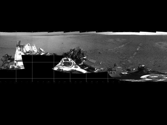 This 360-degree panorama shows evidence of a successful first test drive for NASA's Curiosity rover. On Aug. 22, 2012, the rover made its first move, going forward about 15 feet (4.5 meters), rotating 120 degrees and then reversing about 8 feet