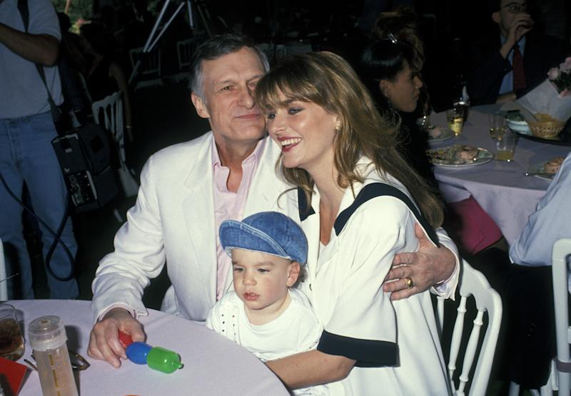Hugh Hefner, Marsden Hefner and wife Kimberly Conrad at the Playboy Playmate of the Year Celebration on April 25, 1991.  (Ron Galella via Getty Images)