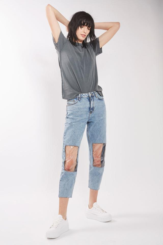 <p>These aren't your momma's mom jeans. A few months ago, Topshop was ridiculed for selling this distrssed denim with clear panels to showcase your knobbly kneecaps. <em>(Photo:Topshop)</em> </p>