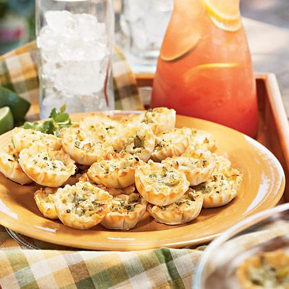 "<div class=""caption-credit""> Photo by: FamilyFun.go.com</div><div class=""caption-title""></div><p>   <b>Chicken Chili Cheese Cups</b> </p> <p>   These dynamite little chicken and cheese quiches are a true kid favorite. Mild green chilies add a southwestern flavor without any of the heat. The pre-made phyllo cups, found in the grocery freezer section, add a slightly fancy touch. </p> <p>   <a rel=""nofollow"" href=""http://familyfun.go.com/recipes/chicken-chili-cheese-cups-688780/?cmp=OTC_Shine_TeamMomPicnic_FFUN"">Get the Recipe</a> </p>"