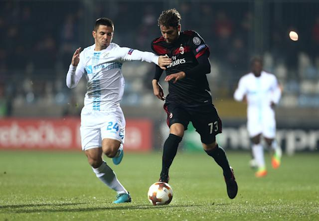 Soccer Football - Europa League - HNK Rijeka vs AC Milan - Stadion HNK Rijeka, Rijeka, Croatia - December 7, 2017 AC Milan's Manuel Locatelli in action with Rijeka's Domagoj Pavicic REUTERS/Antonio Bronic
