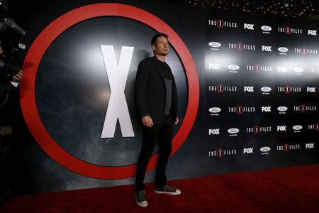 """FILE PHOTO: Cast member David Duchovny poses at a premiere for """"The X-Files"""" at California Science Center in Los Angeles, California, U.S. on January 12, 2016.  REUTERS/Mario Anzuoni/File Photo"""