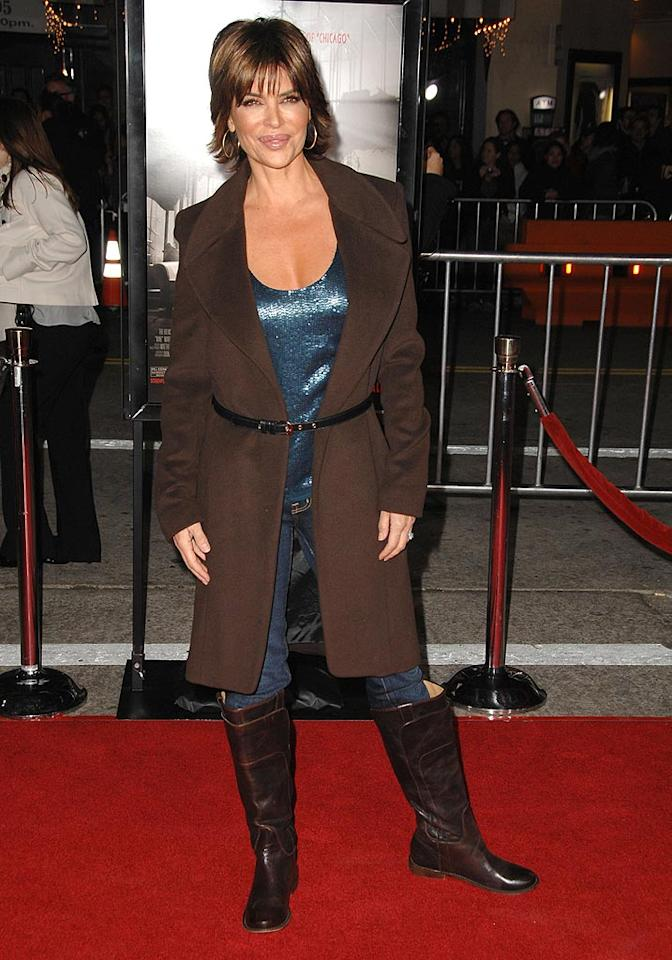"Speaking of belted bombs, look at what Lisa Rinna wore to the ultra glamorous premiere of ""Nine."" And, don't get us started on those ill-fitting boots! Steve Granitz/<a href=""http://www.wireimage.com"" target=""new"">WireImage.com</a> - December 9, 2009"