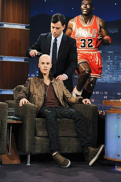 "OMG! Did Justin Bieber shave off his signature shag? The singer stopped by ""Jimmy Kimmel Live!"" for a trim, and ended up ... bald? ""Yeah it's great, [the girls] will just focus on my beautiful silky smooth lyrics,"" Justin joked after his new look had been revealed. Calm down Beliebers. Turns out the close shave was all a stunt -- JBiebs beautiful hair is still fully intact! ABC/MITCH HADDAD"