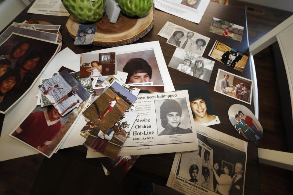 FILE - In this Aug. 12, 2019, file photo, family photographs of Jonelle Matthews, who went missing just before Christmas 1984 and whose remains were found in Greeley, Colo. in 2019, sit on a table in a home in Greeley. The trial for Steve Pankey, a former longshot candidate for Idaho governor who has been indicted in the murder of Jonelle Matthews, is set to begin Wednesday, Oct. 13, 2021. (AP Photo/David Zalubowski, File)