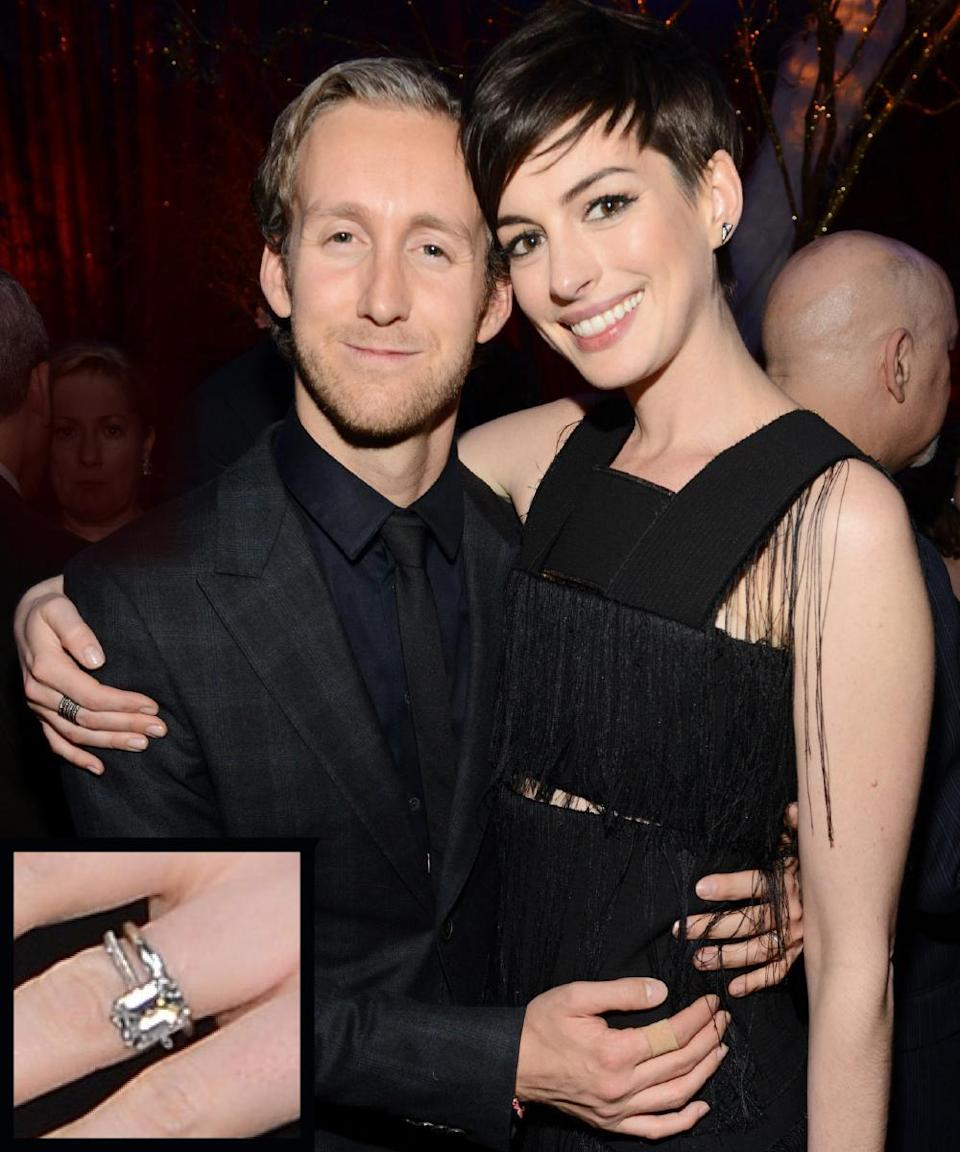 """<p>Actor Adam Shulman popped the question to Anne Hathaway in 2011 and presented the actress with a custom emerald-cut ring by the New York jewelry company <a rel=""""nofollow noopener"""" href=""""http://news.instyle.com/2011/11/29/anne-hathaway-engagement-ring-adam-schulman/"""" target=""""_blank"""" data-ylk=""""slk:Kwiat"""" class=""""link rapid-noclick-resp"""">Kwiat</a>.</p>"""