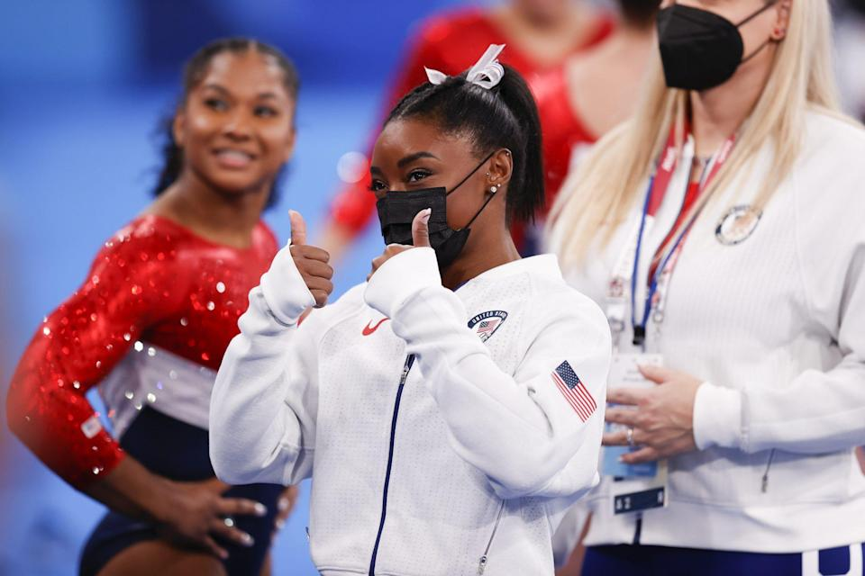 """<p>On July 29, Biles <a href=""""https://people.com/sports/tokyo-olympics-simone-biles-speaks-out-after-pulling-out-individual-all-around/"""" rel=""""nofollow noopener"""" target=""""_blank"""" data-ylk=""""slk:spoke about her mental health concerns"""" class=""""link rapid-noclick-resp"""">spoke about her mental health concerns</a> and <a href=""""https://people.com/sports/tokyo-olympics-simone-biles-addresses-critics-twisties-mental-health/"""" rel=""""nofollow noopener"""" target=""""_blank"""" data-ylk=""""slk:why she chose to withdraw"""" class=""""link rapid-noclick-resp"""">why she chose to withdraw</a>, hours before she was seen <a href=""""https://people.com/sports/tokyo-olympics-simone-biles-mykayla-skinner-jordan-chiles-grace-mccallum-cheer-teammates-gymnastics-individual-all-around/"""" rel=""""nofollow noopener"""" target=""""_blank"""" data-ylk=""""slk:cheering for Lee and Carey in the stands"""" class=""""link rapid-noclick-resp"""">cheering for Lee and Carey in the stands</a>.</p> <p>""""For anyone saying I quit. I didn't quit, my mind & body are simply not in sync as you can see here,"""" Biles shared on social media, including a clip of her practice routine on bars that morning. """"I don't think you realize how dangerous this is on hard/competition surface nor do I have to explain why I put health first.""""</p> <p>In another clip, Biles explained: """"No this was not happening before I left the USA,"""" and """"it randomly started happening after prelims competition the VERY next morning.""""</p> <p>During a Q&A session on her Instagram Story that day, Biles opening up to a fan about """"twisties,"""" the phenomenon gymnasts experience where they lose their understanding of where they are in the air, putting them at risk of injury when they land. </p> <p>""""Literally can not tell up from down. It's the craziest feeling ever. Not having an inch of control over your body. What's even scarier is since I have no idea where I am in the air I also have NO idea how I'm going to land or what I'm going to land on,"""" Biles said.</p> <p>At the time, she had four individual eve"""