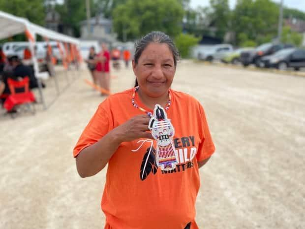 Patricia Ballantyne, who started the Walk of Sorrow in Saskatchewan, wears a beaded medallion she was given on her journey to Ottawa. (Holly Caruk/CBC - image credit)