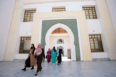 Students walk to attend religious courses at Mohammed VI Institute for training Imams in Rabat, Morocco April 16, 2019. REUTERS/Youssef Boudlal