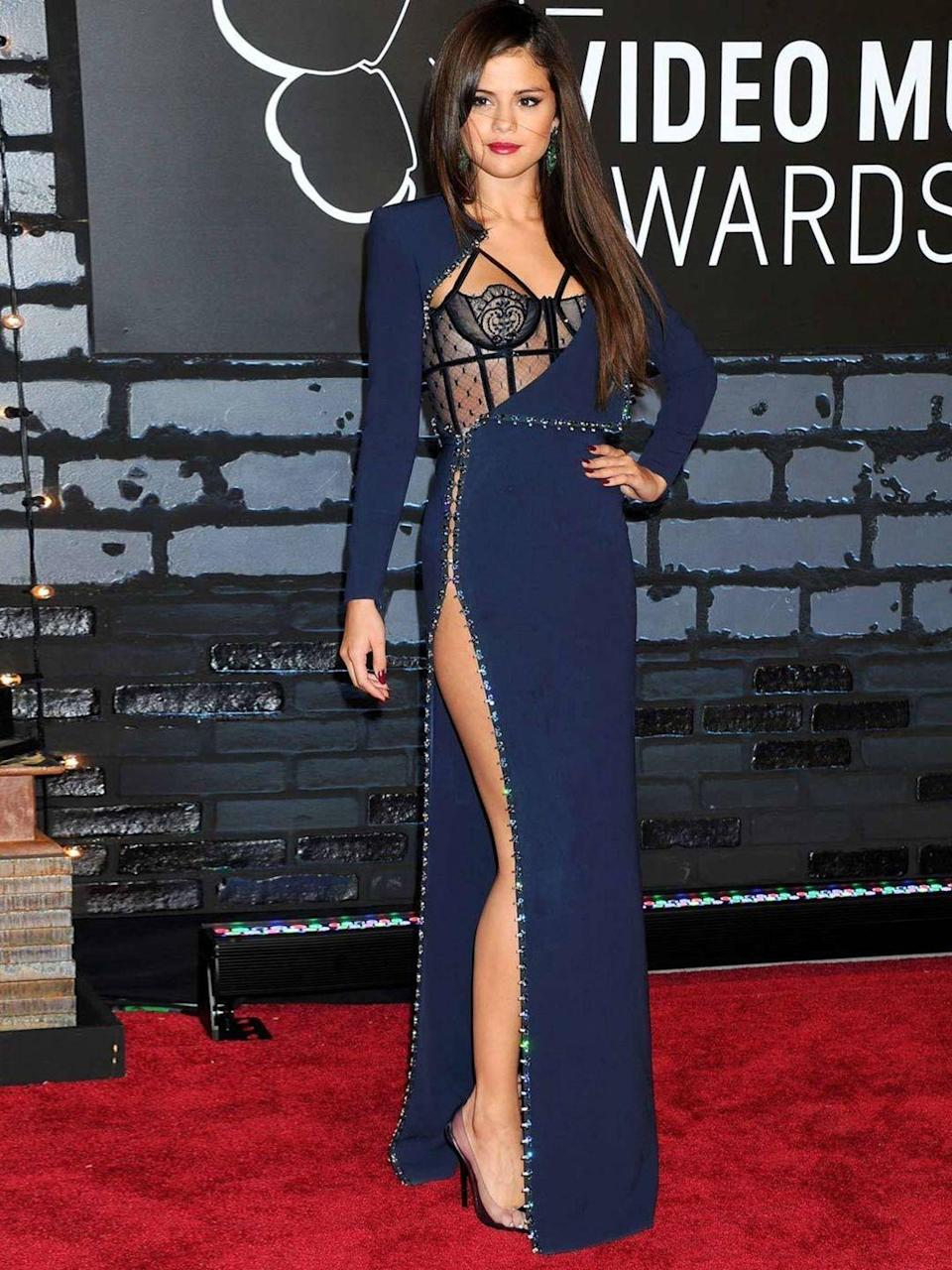 <p>Selena Gomez is at the MTV Video Music Awards in a thigh high slit dress by Atelier Versace, August 2013.</p>