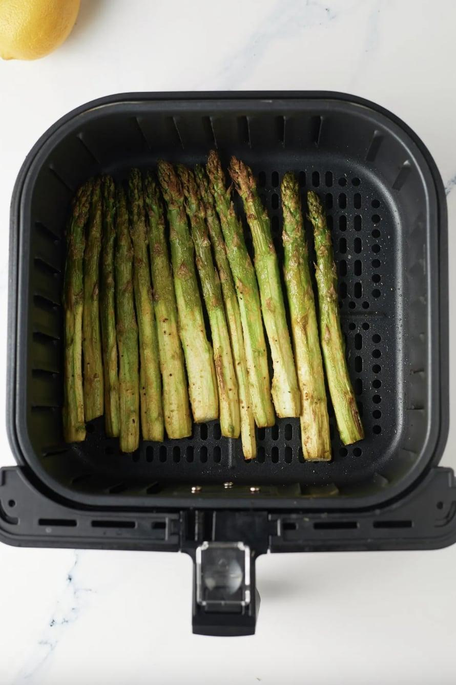 """<p>Get your daily dose of greens when you make this easy recipe. Seasoned with garlic, lemon pepper, and salt, these asparagus bites will be your go-to dinner side dish.</p> <p><strong>Get the recipe</strong>: <a href=""""https://www.myforkinglife.com/air-fryer-asparagus/"""" class=""""link rapid-noclick-resp"""" rel=""""nofollow noopener"""" target=""""_blank"""" data-ylk=""""slk:seasoned air fryer asparagus"""">seasoned air fryer asparagus</a></p>"""