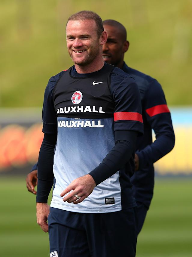 BURTON-UPON-TRENT, ENGLAND - AUGUST 12: Wayne Rooney of England looks on during a training session at St Georges Park on August 12, 2013 in Burton-upon-Trent, England. (Photo by Alex Livesey/Getty Images)