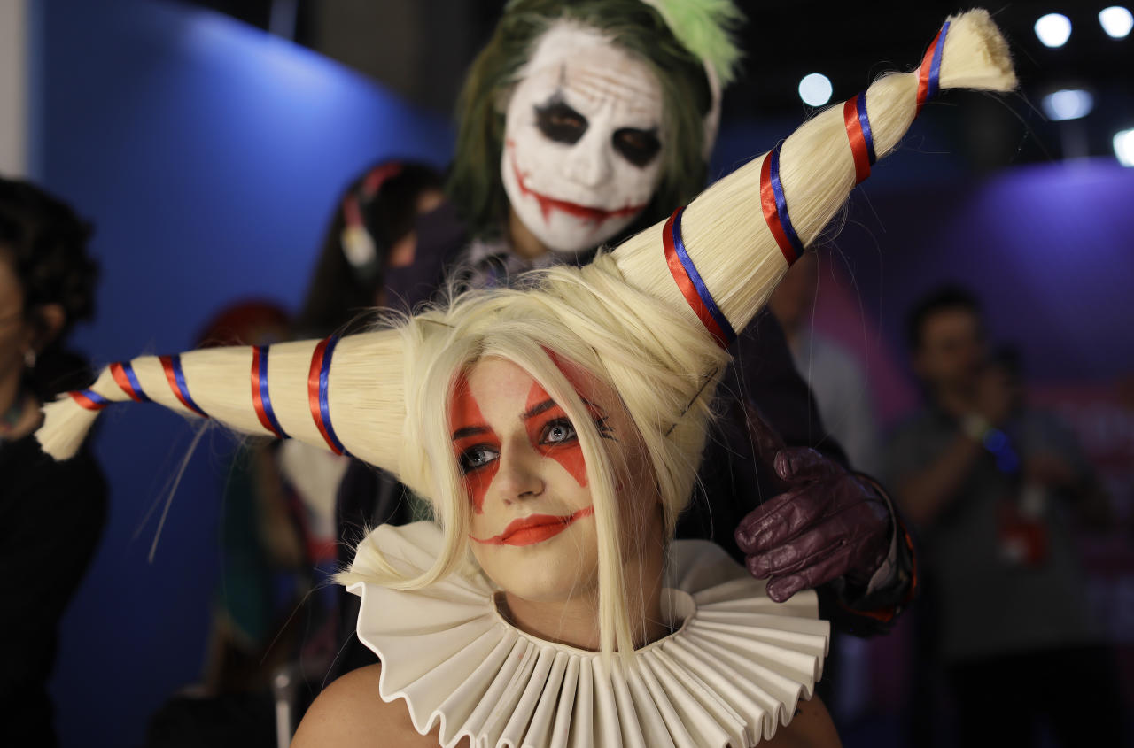 <p>A participant dressed as character Harley Quinn from DC Comics prepares backstage to cosplay at the Comic Con Experience fair in Sao Paulo, Brazil, Thursday, Dec. 6, 2018. The 5th edition of the annual international comic trade fair runs to Dec. 9. (AP Photo/Andre Penner) </p>