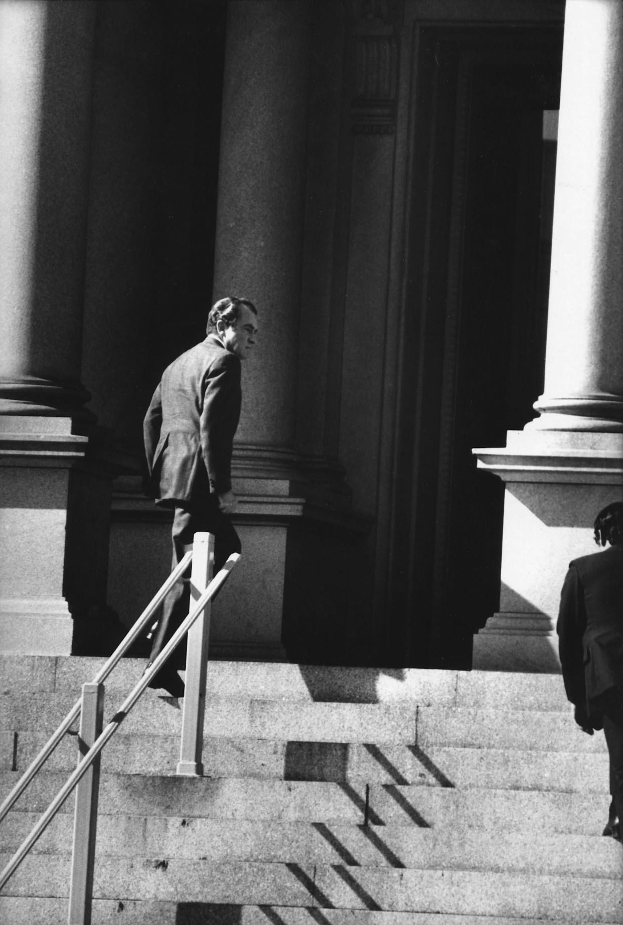 WASHINGTON - OCTOBER 25: (NO U.S. TABLOID SALES) US President Richard Nixon hurries up the steps of the Executive Office Building after briefing Congressional leaders in the Middle East Crisis on October, 25 1973 in Washington, DC. (Photo by David Hume Kennerly/Getty Images)