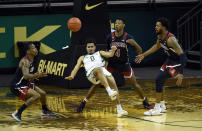Oregon guard Will Richardson (0) falls as he passes while being defended by Arizona guard James Akinjo (13), guard Dalen Terry (4) and forward Jordan Brown (21) during the first half of an NCAA college basketball game Monday, March 1, 2021, in Eugene, Ore. (AP Photo/Andy Nelson)