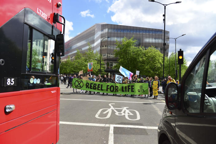 The Extinction Rebellion group block a road close to St Pauls tube station (Getty)