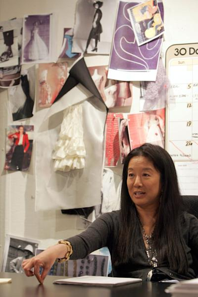 FILE - This June 14, 2005 file photo shows fashion designer Vera Wang gestures during an interview in her studio in New York. Wang, 63, was honored for her lifetime achievement by the Council of Fashion Designers at its star-studded awards show Monday night. She received the award from her former employer and mentor Ralph Lauren, and she received a standing ovation from her peers. (AP Photo/Mary Altaffer, file)