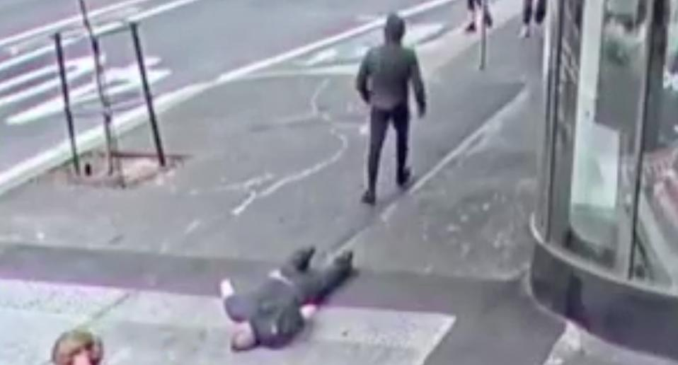 Photo shows man on street in Sydney after being knocked unconscious.