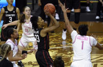 Stanford guard Kiana Williams (23) drives the lane past Oregon guard Te-Hina Paopao (12), Oregon guard Taylor Mikesell (11) and Oregon forward Nyara Sabally (1) during the first half of an NCAA college basketball game Monday, Feb. 15, 2021, in Eugene, Ore. (AP Photo/Andy Nelson)