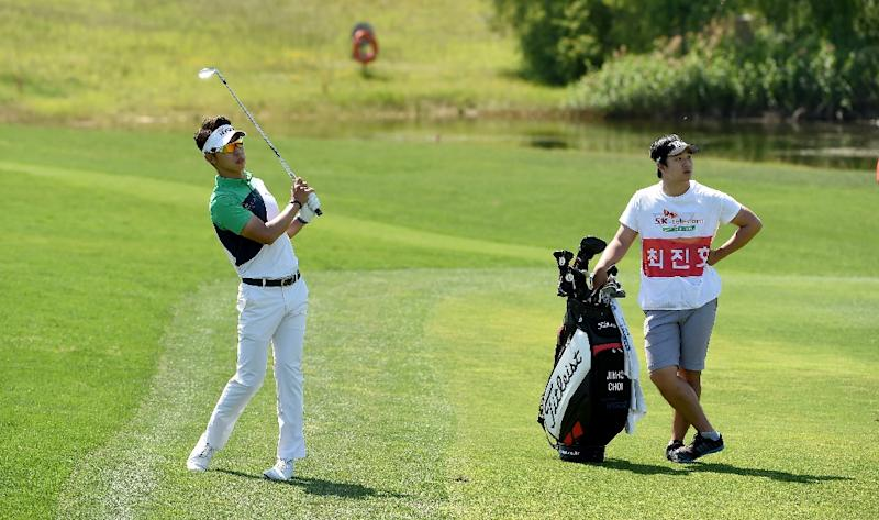 Choi jin-ho hits a shot during the final round of the SK Telecom Open in Seoul on May 24, 2015