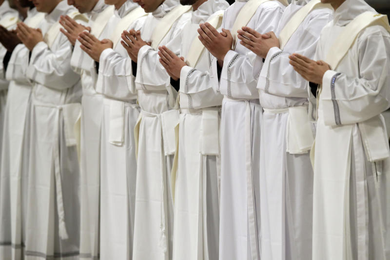 Newly ordained priests pray during a ceremony led by Pope Francis in St. Peter's Basilica at the Vatican, Sunday, May 12, 2019. (AP Photo/Alessandra Tarantino)