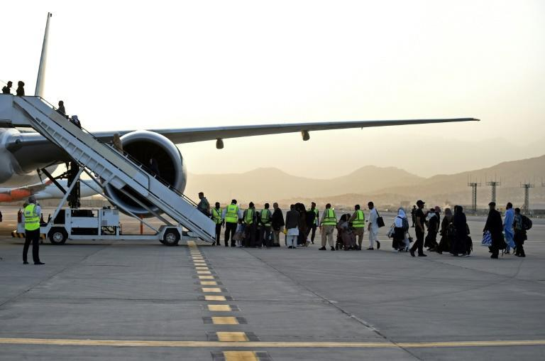 Passengers board a Qatar Airways aircraft at the airport in Kabul on September 9, 2021, the first flight to leave since the US withdrawal was completed (AFP/WAKIL KOHSAR)