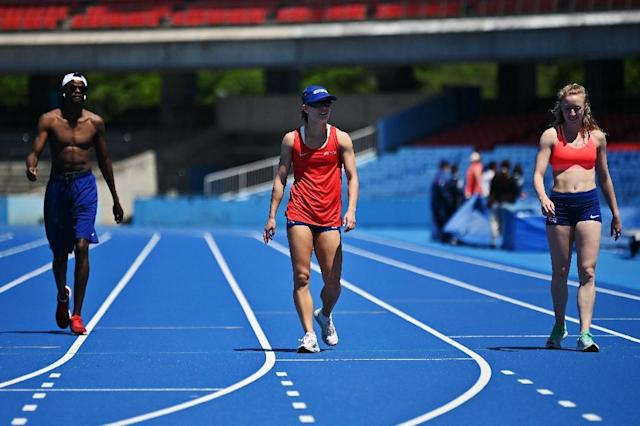 One of the difficulties is passing the baton between taller male athletes and shorter women (AFP Photo/Charly TRIBALLEAU)