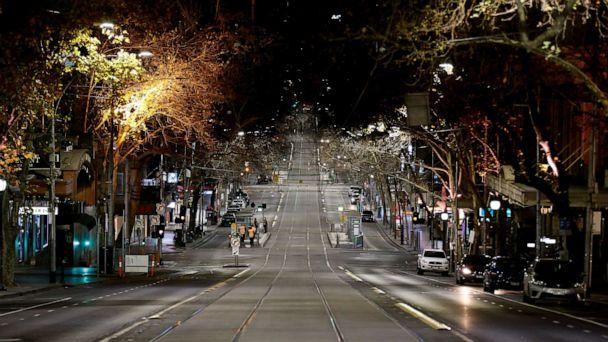 PHOTO: A general view of Collins Street after 8pm as an 8pm to 5am curfew has been introduced starting, Aug. 2, 2020, in Melbourne, Australia. (Darrian Traynor/Getty Images)