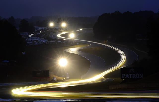 Cars go through the esses during night practice for the American Le Mans Series' Petit Le Mans auto race at Road Atlanta, Thursday, Oct. 17, 2013, in Braselton, Ga. (AP Photo/Rainier Ehrhardt)