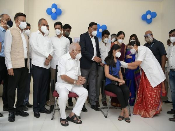 A girl being vaccinated in front of Chief Minister BS Yediyurappa at Bowring and Lady Curzon Hospital in Bengaluru on Saturday. (Photo/ANI)