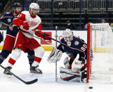 Columbus Blue Jackets goalie Matiss Kivlenieks, right, stops a shot in front of Detroit Red Wings forward Valtteri Filppula, center, and Blue Jackets defenseman Vladislav Gavrikov during the first period of an NHL hockey game in Columbus, Ohio, Saturday, May 8, 2021. (AP Photo/Paul Vernon)
