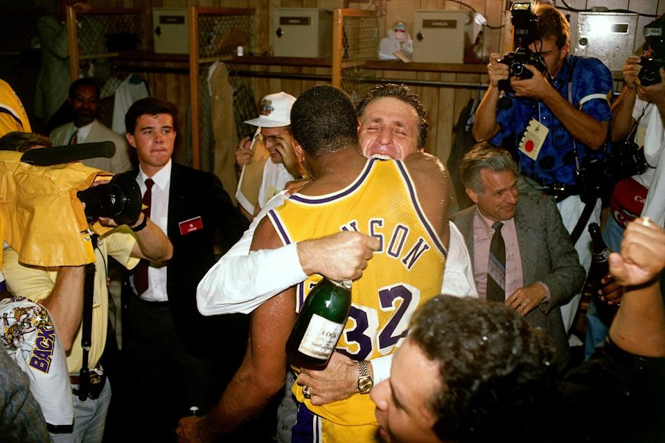 Coach Pat Riley and Magic Johnson embrace during the locker-room celebration capturing the 1988 NBA title.
