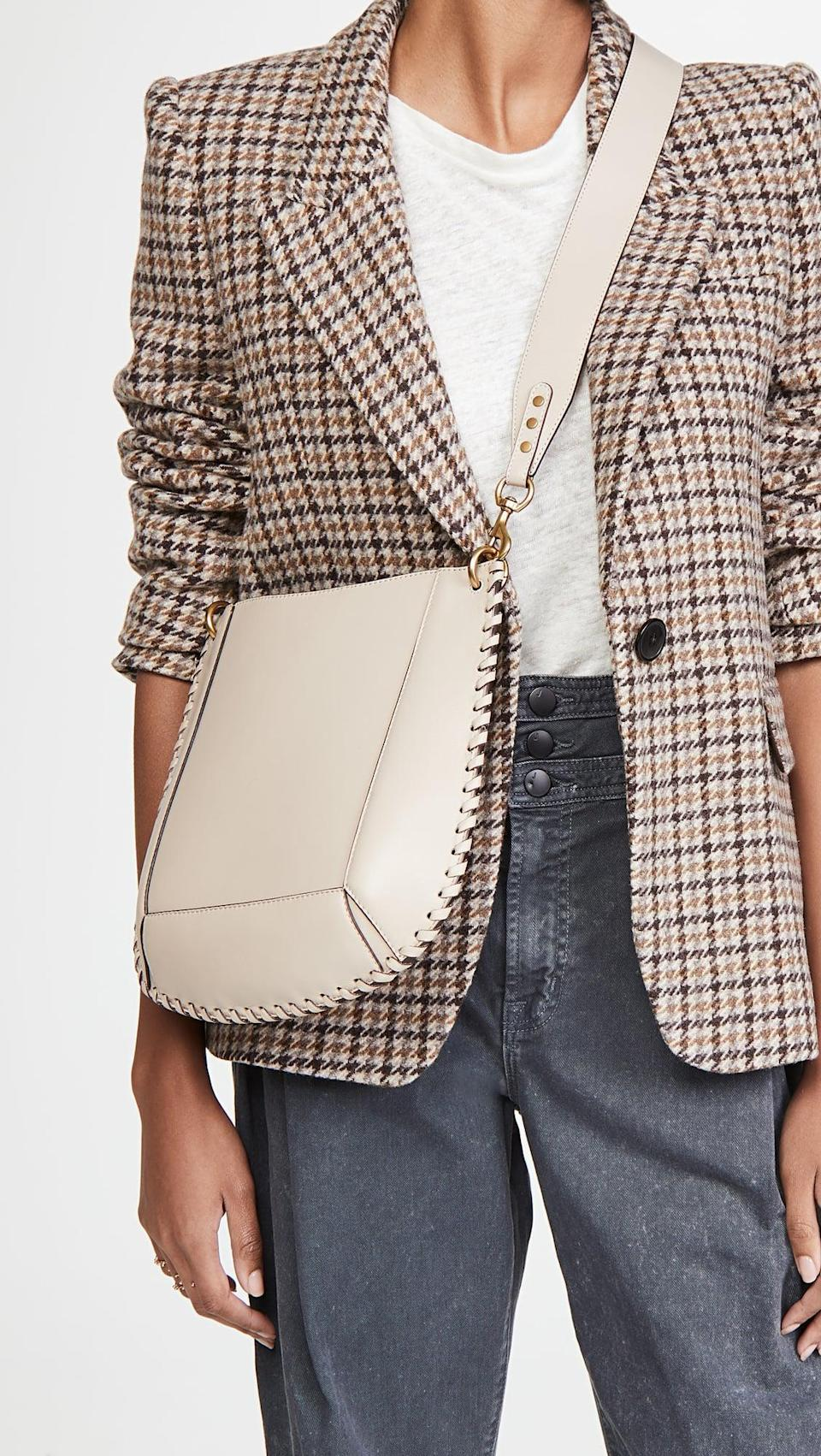 <p>We're obsessed with everything about this <span>Isabel Marant Oskan New Crossbody Bag</span> ($890). The color, the studs, it's everything we need in an everyday bag.</p>