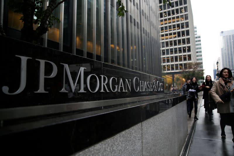 FILE PHOTO: A sign of JP Morgan Chase Bank is seen in front of their headquarters tower in New York