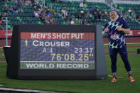 Ryan Crouser poses after setting a world record during the finals of men's shot put at the U.S. Olympic Track and Field Trials Friday, June 18, 2021, in Eugene, Ore. (AP Photo/Charlie Riedel)