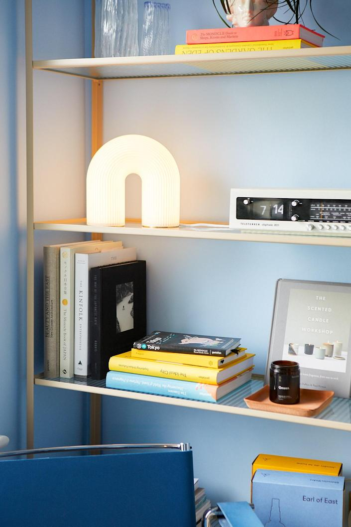 The couple's own products peek out on their shelf: Duo Gift Sets in Shinrin-Yoku and Jardin de la Lune and an Onsen candle.