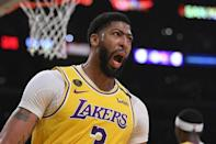 Los Angeles Lakers forward Anthony Davis reacts after scoring during the first half of an NBA basketball game against the Philadelphia 76ers Tuesday, March 3, 2020, in Los Angeles. (AP Photo/Mark J. Terrill)