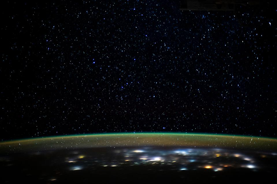 A vivid, green airglow blankets Earth's upper atmosphere under the starry night sky in this view from the International Space Station. An astronaut aboard the station captured this image on Dec. 29, 2019, when the station was orbiting about 260 miles (420 kilometers) above northern Iran, as it was about to pass over the Caspian Sea.