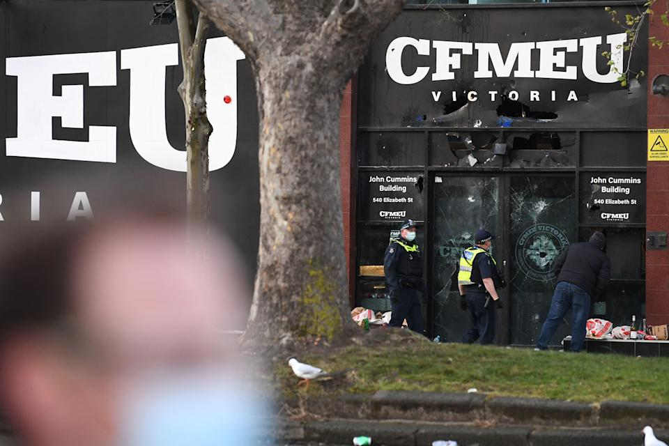 The front of the Construction, Forestry, Maritime, Mining and Energy Union (CFMEU) headquarters was damaged at the protest on Monday. Source: AAP