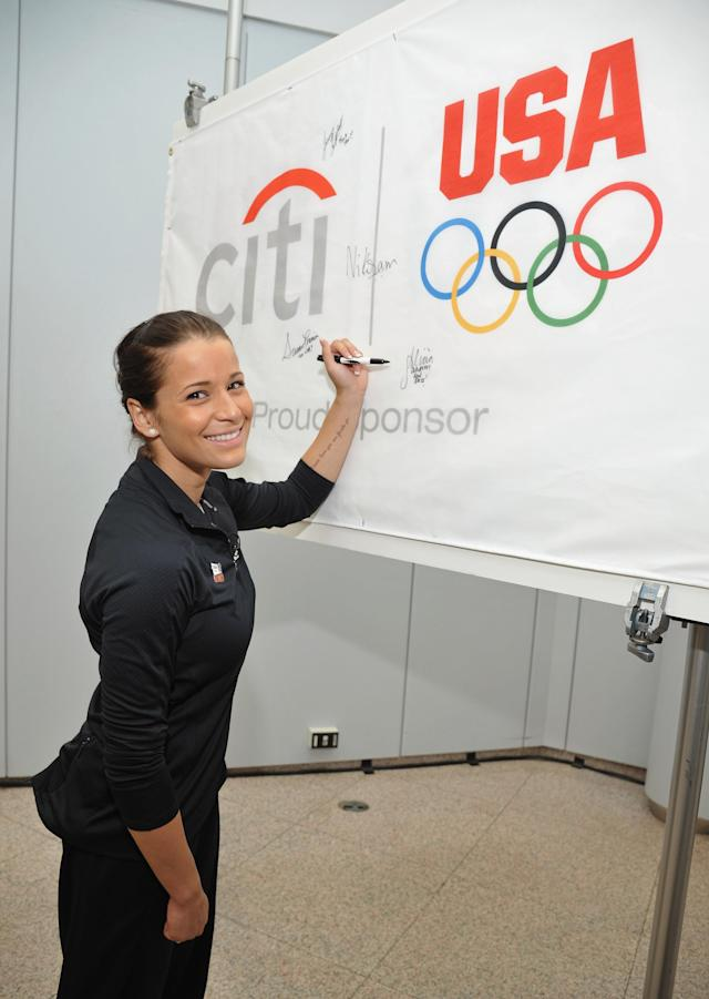 NEW YORK, NY - JULY 27: Olympic silver medalist Alicia Sacramone signs the Citi Team USA Flag inside the financial center at Citi's Headquarters on July 27, 2011 in New York City. (Photo by Mike Coppola/Getty Images for Citi)