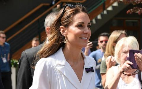 Kate makes her way through Wimbledon to courtside - Credit: Getty