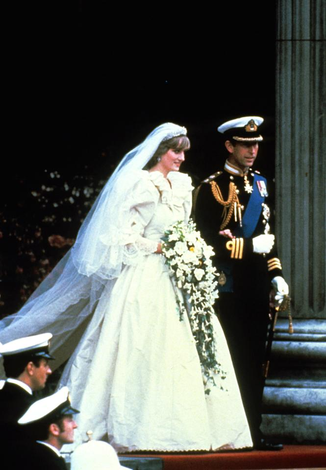 <p>Who could forget the late Princess Di's frothy 80s bridal gown? The beloved royal tied the knot in one huge (and no doubt uncomfortable) David and Elizabeth Emanuel frock, complete with billowing sleeves, train and ruffled neck. <i>[Photo: PA Images]</i></p>