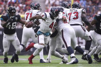 Houston Texans quarterback Deshaun Watson (4) is wrapped up by Jacksonville Jaguars middle linebacker Myles Jack (44) during the first half of an NFL football game Sunday, Sept. 15, 2019, in Houston. (AP Photo/Eric Christian Smith)