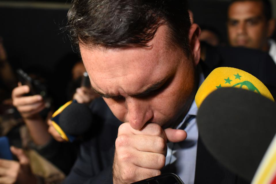 Flavio Bolsonaro, son of Brazil's right-wing presidential frontrunner Jair Bolsonaro, gestures outside Santa Casa hospital where his father was being treated in the southeastern city of Juiz de Fora on September 7, 2018. - Brazil's right-wing presidential frontrunner Jair Bolsonaro was stabbed and seriously injured while campaigning on September 6, with police saying the suspect claimed to be acting on orders from God. (Photo by Fabio TEIXEIRA / AFP)        (Photo credit should read FABIO TEIXEIRA/AFP via Getty Images)