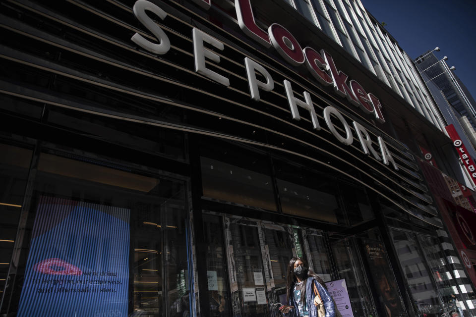 A woman walks outside a Sephora store in New York on Friday, May 7, 2021. The beauty retailer recently announced a commitment to devote at least 15% of its store shelves to Black-owned brands. (AP Photo/Robert Bumsted)