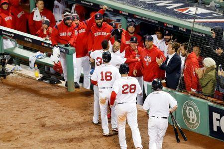 Oct 23, 2018; Boston, MA, USA; Boston Red Sox pinch hitter Eduardo Nunez (36) celebrates with right fielder Mookie Betts (50) after hitting a three run home run against the Los Angeles Dodgers in game one of the 2018 World Series at Fenway Park. Greg M. Cooper-USA TODAY Sports