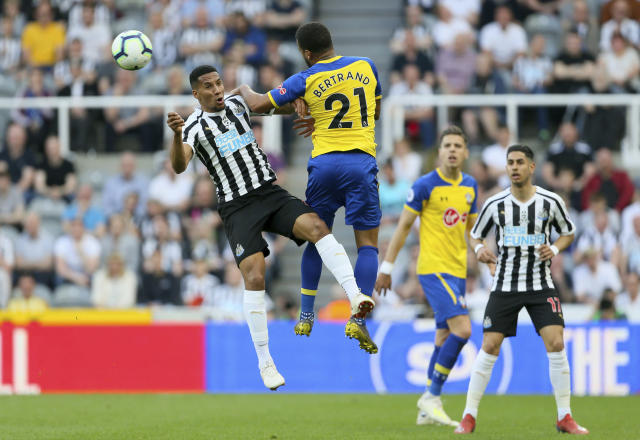Newcastle United's Isaac Hayden, left, and Southampton's Ryan Bertrand in action during their English Premier League soccer match at St James' Park in Newcastle, England, Saturday April 20, 2019. (Richard Sellers/PA via AP)