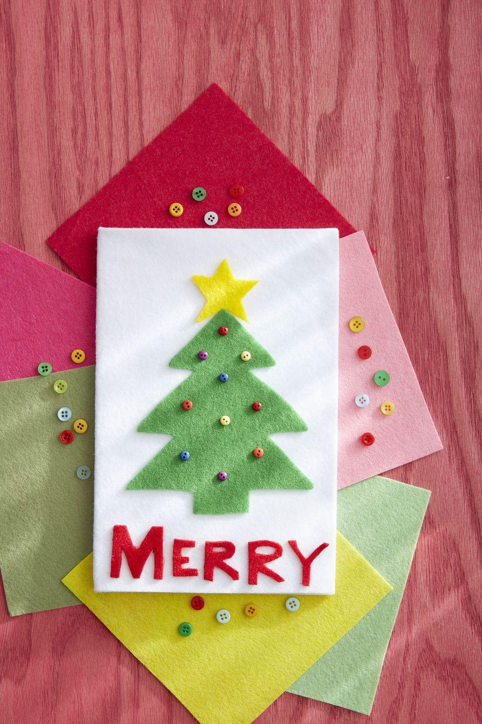 """<p>Soft just like the new slippers you got from Santa, this card is made entirely of felt with button ornament accents. </p><p><strong>To make:</strong> Cut a rectangle from white felt; fold in half to make a card. Cut a tree from green felt and star from yellow felt; glue to the center of the front of the card. Cut letters (you can either freehand them or draw the letters on with a pencil first). Glue letters below the tree. Glue on colorful mini buttons to mimic ornaments.</p><p><a class=""""link rapid-noclick-resp"""" href=""""https://www.amazon.com/flic-flac-inches-Assorted-Fabric-Patchwork/dp/B01N1U85M1/ref=sr_1_6?tag=syn-yahoo-20&ascsubtag=%5Bartid%7C10050.g.3872%5Bsrc%7Cyahoo-us"""" rel=""""nofollow noopener"""" target=""""_blank"""" data-ylk=""""slk:SHOP FELT"""">SHOP FELT</a></p>"""